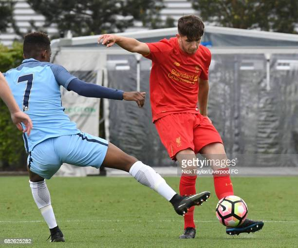 Anthony Glennon of Liverpool and Rabbi Matondo of Manchester City in action during the Manchester City v Liverpool U18 Premier League game at Etihad...
