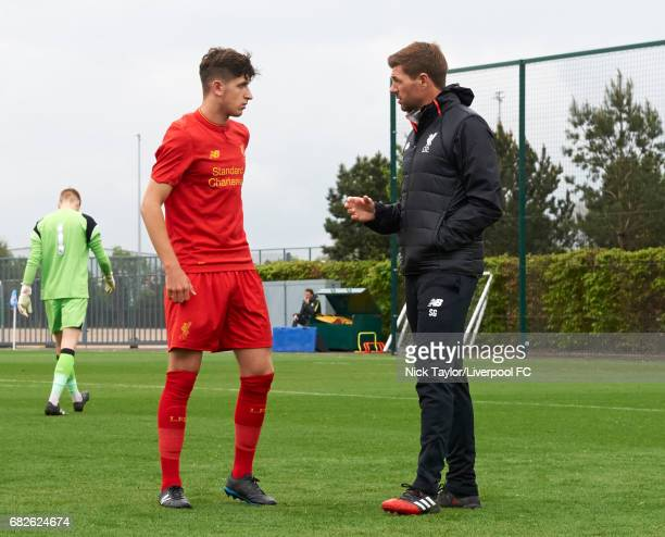 Anthony Glennon of Liverpool talks with coach Steven Gerrard before the Manchester City v Liverpool U18 Premier League game at Etihad Campus on May...