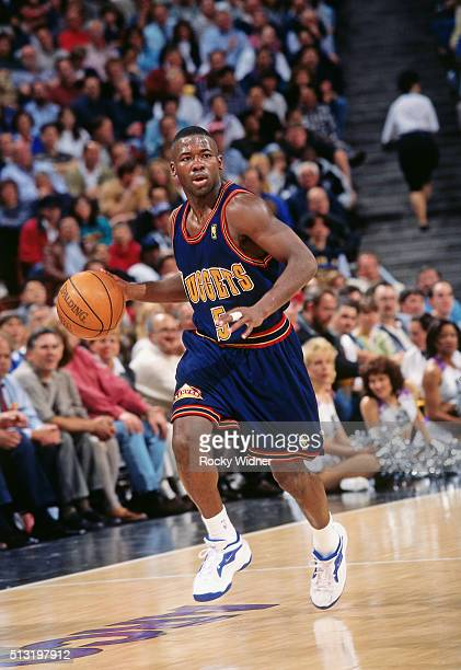 Anthony Goldwire of the Denver Nuggets dribbles against the Sacramento Kings circa 1997 at Arco Arena in Sacramento, California. NOTE TO USER: User...