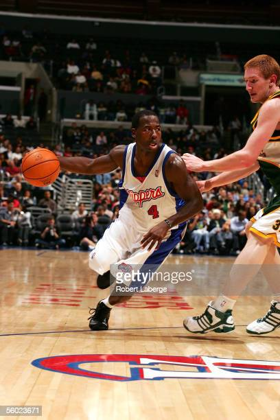 Anthony Goldwire of the Los Angeles Clippers handles the ball against Robert Swift of the Seattle SuperSonics during the NBA preseason game on...