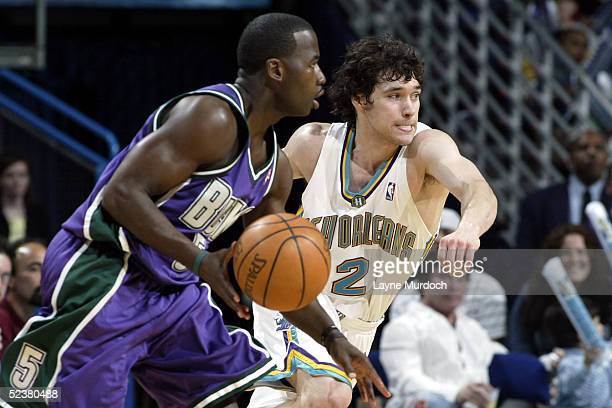 Anthony Goldwire of the Milwaukee Bucks drives around Dan Dickau of the New Orleans Hornets on March 12 2005 at the New Orleans Arena in New Orleans...