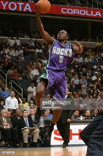 Anthony Goldwire of the Milwaukee Bucks drives to the basket for a layup against the Washington Wizards during the game on April 11th, 2005 at the...