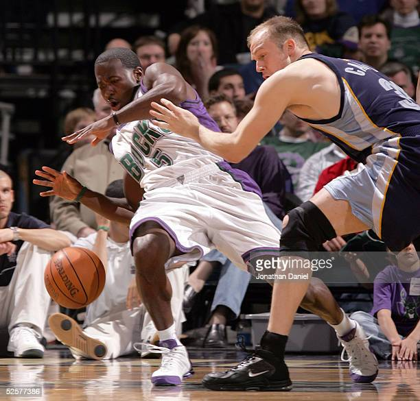 Anthony Goldwire of the Milwaukee Bucks loses control of the ball after being pushed by Brian Cardinal of the Memphis Grizzlies on April 1, 2005 at...