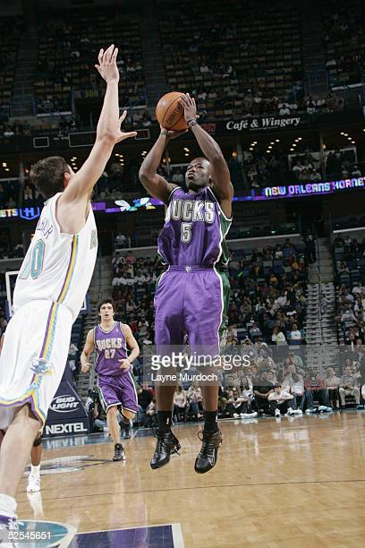 Anthony Goldwire of the Milwaukee Bucks shoots over Bostjan Nachbar of the New Orleans Hornets during the game on March 12 2005 at the New Orleans...