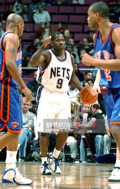 Anthony Goldwire of the New Jersey Nets gives signal for play against Moochie Norris of the New York Knicks on April 2, 2004 at Continental Airlines...