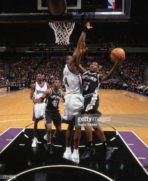 Anthony Goldwire of the San Antonio Spurs goes up for the shot over Chris Webber of the Sacramento Kings during the game at Arco Arena on December...