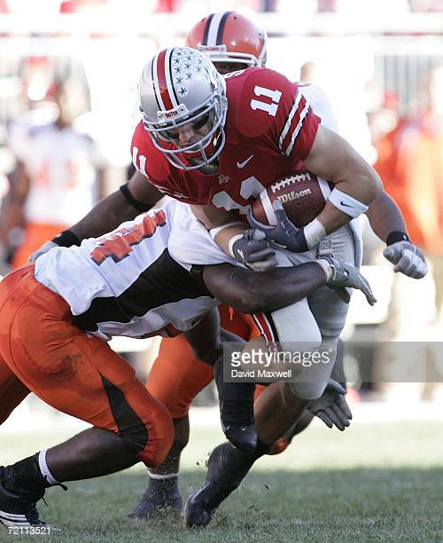 Anthony Gonzalez of the Ohio State Buckeyes is tackled by Jahmal Brown and Calvin Wiley of the Bowling Green Falcons after gaining a first down...