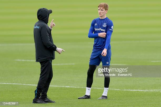 Anthony Gordon is spoken to by Carlo Ancelotti during the Everton training session at USM Finch Farm on June 3 2020 in Halewood England