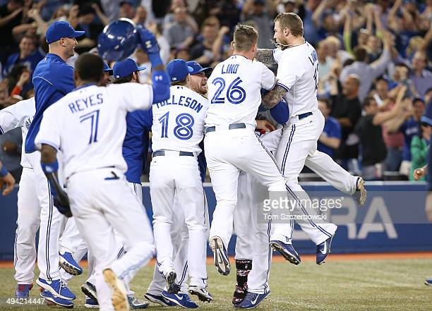 Anthony Gose of the Toronto Blue Jays is embraced after his sacrifice bunt led to a throwing error and the victory in the ninth inning during MLB...