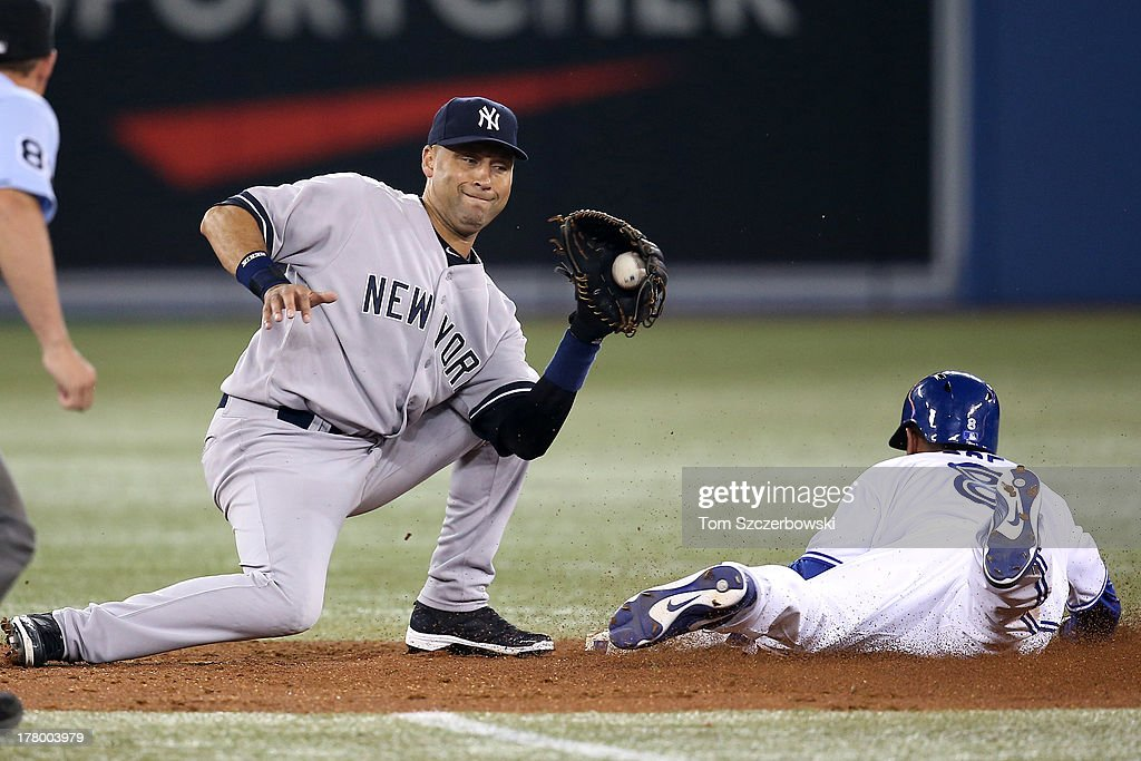 Anthony Gose #8 of the Toronto Blue Jays steals second base in the sixth inning during MLB game action as Derek Jeter #2 of the New York Yankees applies the tag on August 26, 2013 at Rogers Centre in Toronto, Ontario, Canada.
