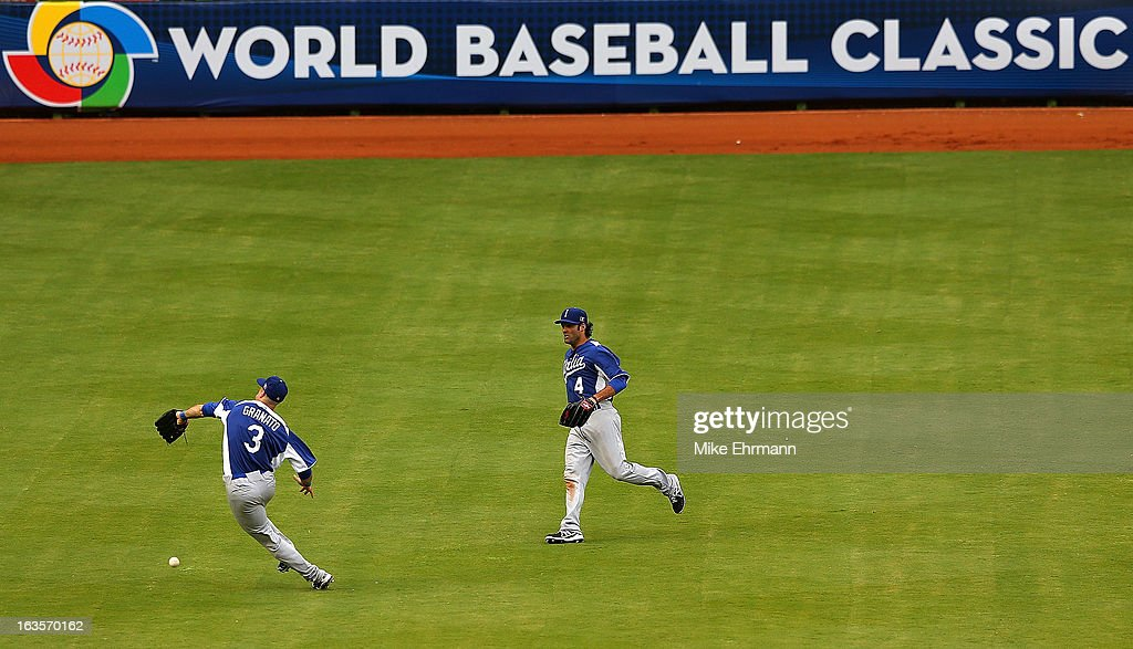 Anthony Granato #3 and Mike Costanzo #4 of Italy missplay a fly ball during a World Baseball Classic second round game against the Dominican Republic at Marlins Park on March 12, 2013 in Miami, Florida.