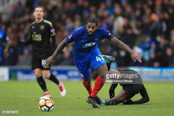 Anthony Grant of Peterborough United in action with Kelechi Iheanacho of Leicester City during the FA Cup 4th Round match between Peterborough United...