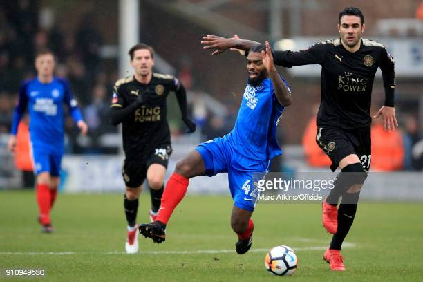 Anthony Grant of Peterborough United in action with Vicente Iborra of Leicester City during the FA Cup 4th Round match between Peterborough United...