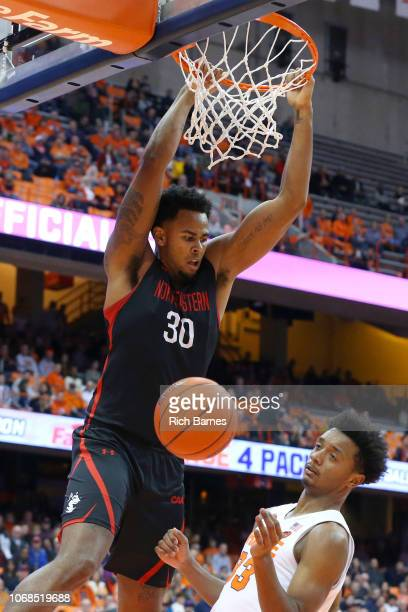 Anthony Green of the Northeastern Huskies reacts to his dunk over Elijah Hughes of the Syracuse Orange defends during the first half at the Carrier...