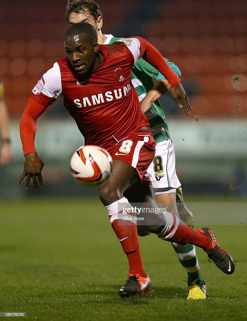 Anthony Griffith of Leyon Orient is challenged by Ed Upson of Yeovil Town during the Johnstone's Paint Trophy southern section semi final between Leyton Orient and Yeovil Town at the Matchroom Stadium on January 8, 2013 in London, England.