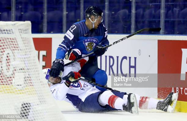Anthony Guttig of France challenges Juhani Tyrvainen of Finland during the 2019 IIHF Ice Hockey World Championship Slovakia group A game between...