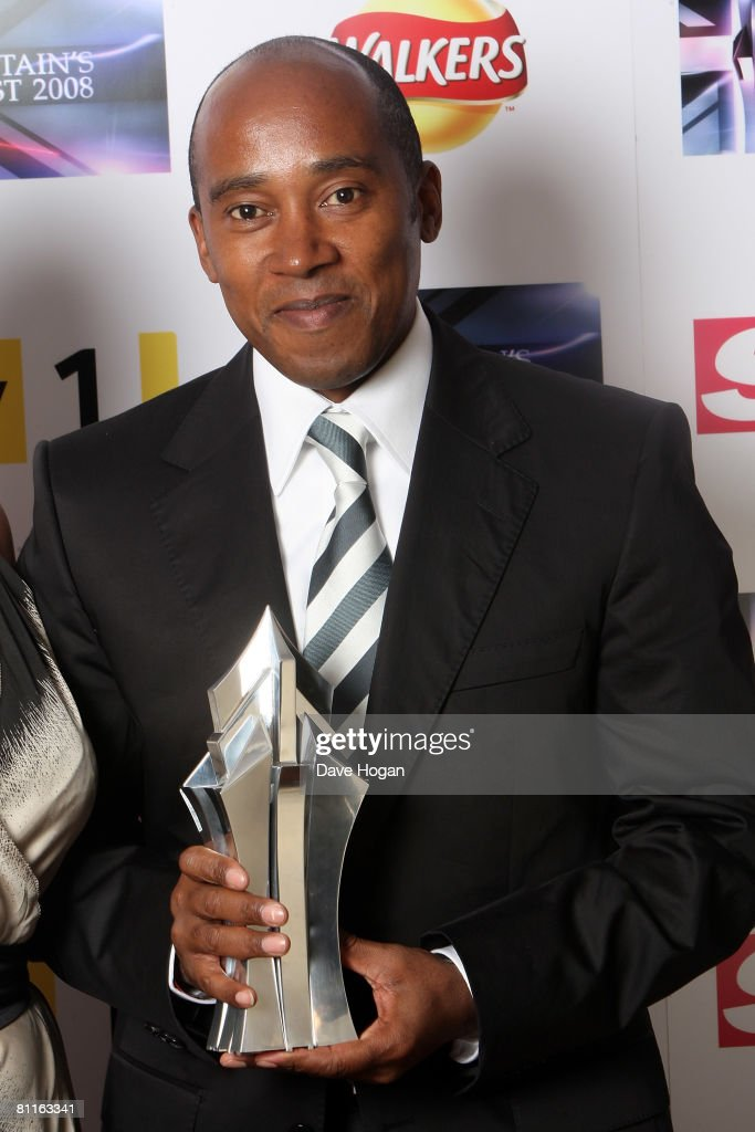Anthony Hamilton, father of Formula One racing driver Lewis Hamiliton, poses in front of the winners' boards with his son's Britain's Best in Sport Award at the Britain's Best 2008 Awards at London Television Studios on May 18, 2008 in London, England. The award ceremony honours outstanding Britons in categories including business, art, television, music, film, sport and fashion.
