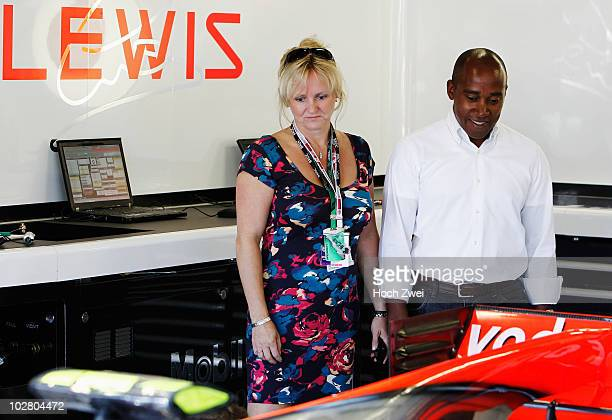 Anthony Hamilton father of Lewis Hamilton of Great Britain and McLaren Mercedes is seen in their team garage with his wife Linda during qualifying...