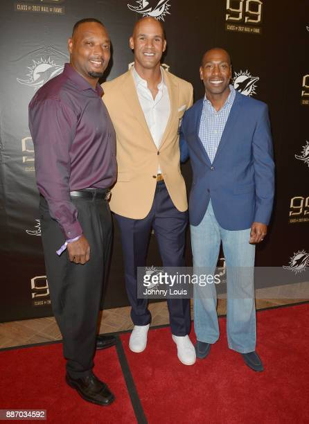 Anthony Harris Jason Taylor and Sam Madison attend The Miami Dolphins 'Hall of Fame Celebration' hosting Jason Taylor at Hard Rock Stadium on...