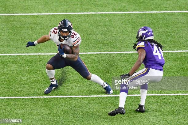 Anthony Harris of the Minnesota Vikings attempts to tackle David Montgomery of the Chicago Bears during the second half at U.S. Bank Stadium on...