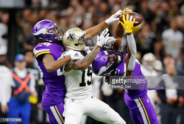 Anthony Harris of the Minnesota Vikings intercepts a pass during the second quarter against the New Orleans Saints in the NFC Wild Card Playoff game...