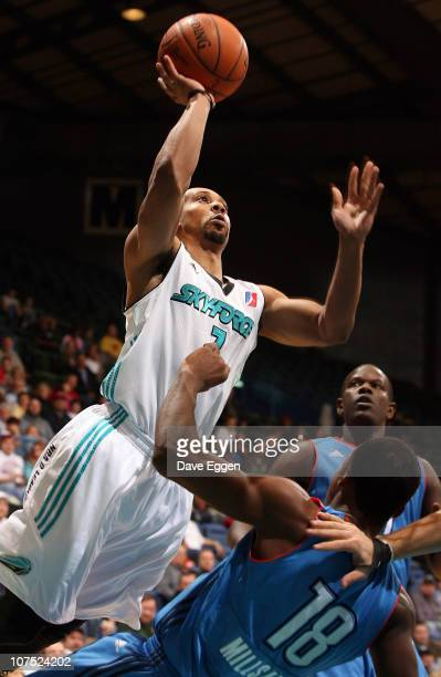 Anthony Harris of the Sioux Falls Skyforce is called for the offensive foul as he drives into Elijah Millsap of the Tulsa 66ers in the first half of...