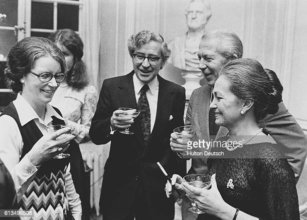 Anthony Hewish the English radio astronomer enjoys a drink with fellow guests at the 1974 Nobel Prize reception in Stockholm He shared the prize for...