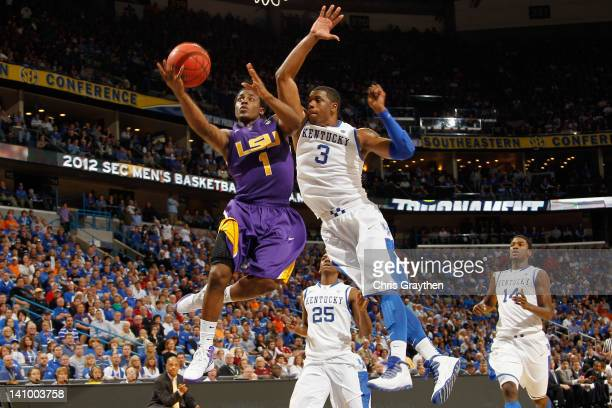 Anthony Hickey of the LSU Tigers shoots the ball over Terrence Jones of the Kentucky Wildcats during the quarterfinals of the SEC Men's Basketball...