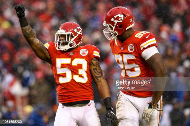 Anthony Hitchens and teammate Chris Jones of the Kansas City Chiefs celebrates a defensive stop against the Indianapolis Colts during the first half...