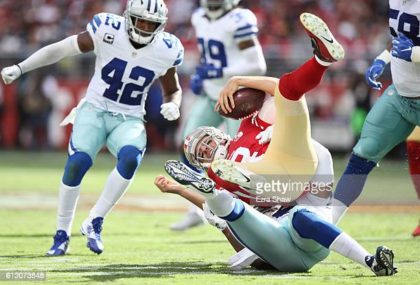 Anthony Hitchens of the Dallas Cowboys sacks quarterback Blaine Gabbert of the San Francisco 49ers during the fourth quarter at Levi's Stadium on...