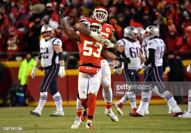 Anthony Hitchens of the Kansas City Chiefs and Chris Jones celebrate after stopping the New England Patriots on fourth down in the second half during...