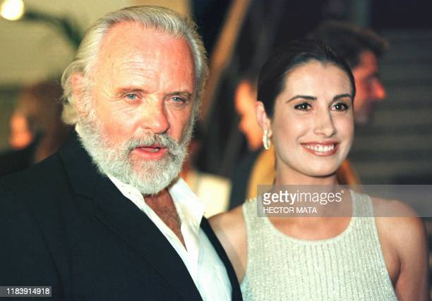 Anthony Hopkins and Mexican actress Julieta Rosen pose for photographers upon their arrival at the Tri Star premiere of The Mask of Zorro 10 July in...