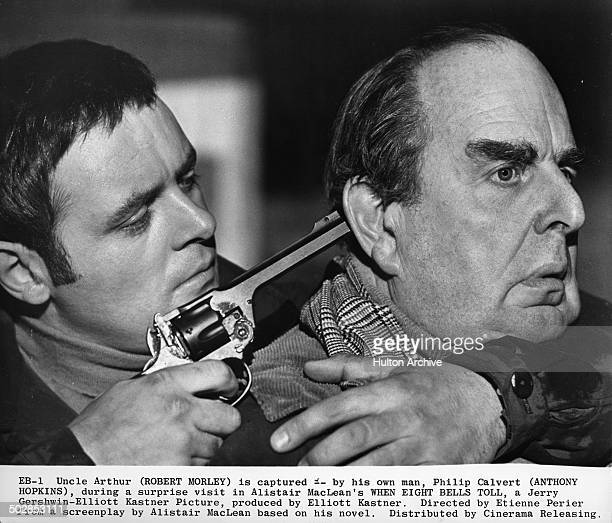 Anthony Hopkins grabs Robert Morley in a scene for the movie 'When Eight Bells Toll' circa 1970