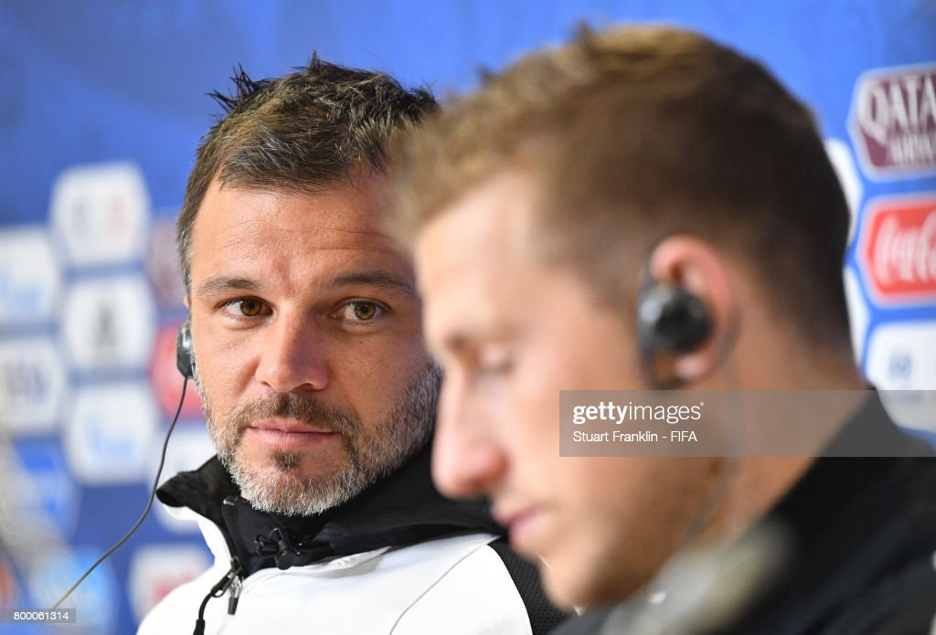 Anthony Hudson, head coach looks over at Captain Chris Wood during a press conference after a training session of the New Zealand national football team on June 23, 2017 in Saint Petersburg, Russia.