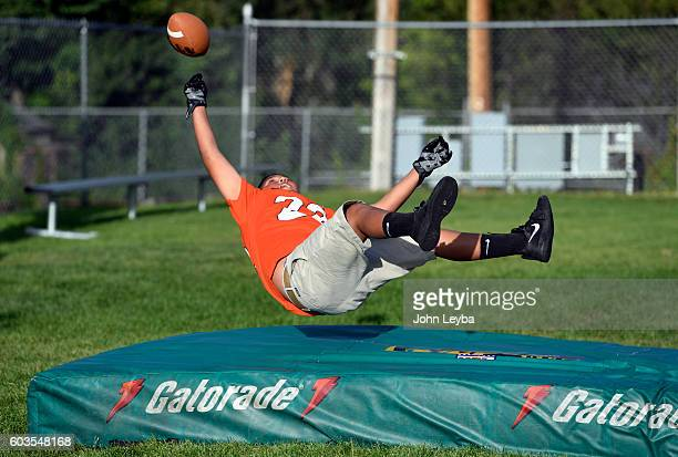 Anthony Hurtado 13 years old goes up high for a pass from Denver Broncos wide receiver Cody Latimer during the Fall 2016 NGL Play 60 The Denver...