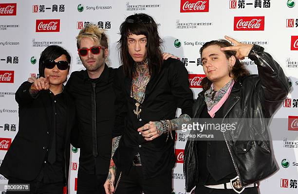 Anthony Improgo Blake Healy Trace Cyrus and Mason Musso of Metro Station pose on the red carpet during the MTV Video Music Awards Japan 2009 at...