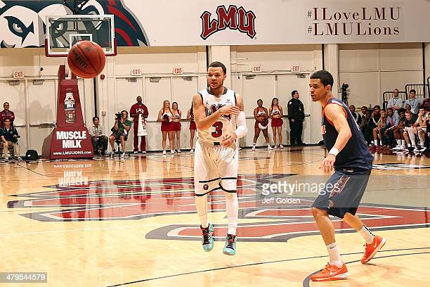 Anthony Ireland of the Loyola Marymount Lions watches the flight of his pass against Malcolm Brooks of the Pepperdine Waves in the first half of the...