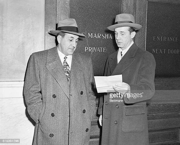 Anthony J Accardo the reputed kingpin in a nationwide crime syndicate reads the subpoena from the Senate Crime Investigating Committee that his...