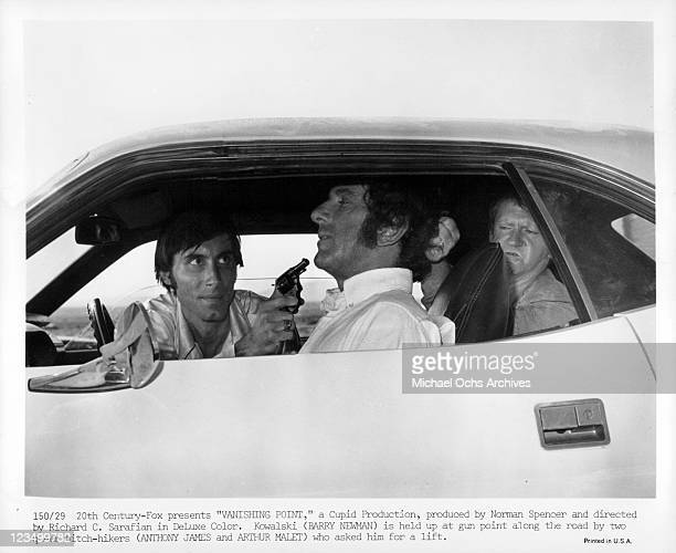 Anthony James and Arthur Malet hold up Barry Newman in a scene from the film 'Vanishing Point' 1971