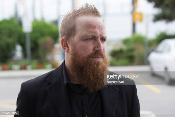 TORONTO ON JULY 13 Anthony James Kiss stands outside Finch court during a hearing a case involving a hit and run incident he was driving in and...