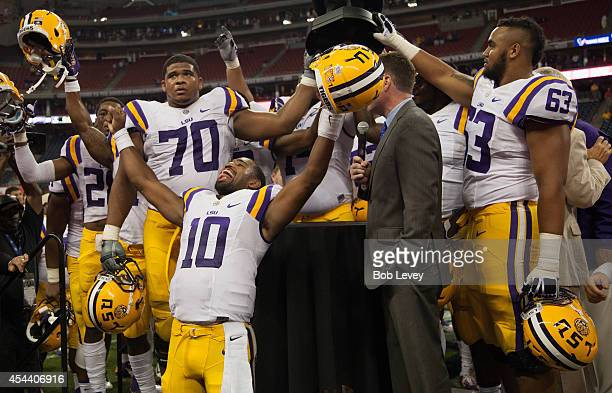 Anthony Jennings of the LSU Tigers celebrates with La'el Collins and KJ Malone at NRG Stadium on August 30 2014 in Houston Texas