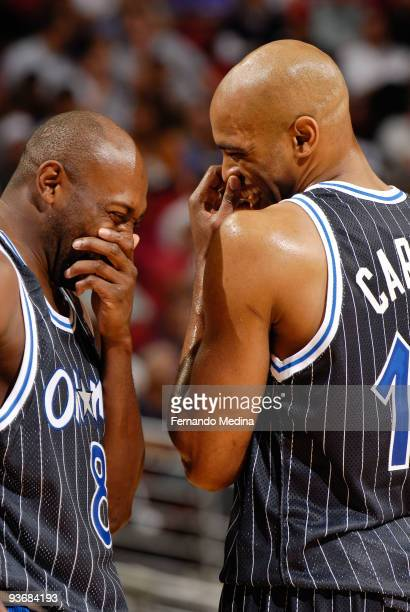 Anthony Johnson and Vince Carter of the Orlando Magic attempt to hide and suppress their laughter during the game against the New York Knicks on...