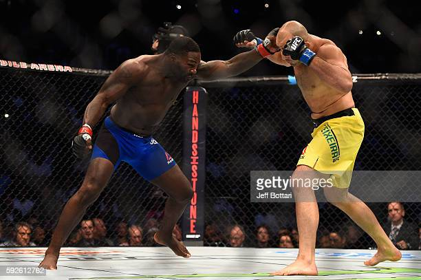 Anthony Johnson fights Glover Teixeira of Brazil in their light heavyweight bout during the UFC 202 event at TMobile Arena on August 20 2016 in Las...