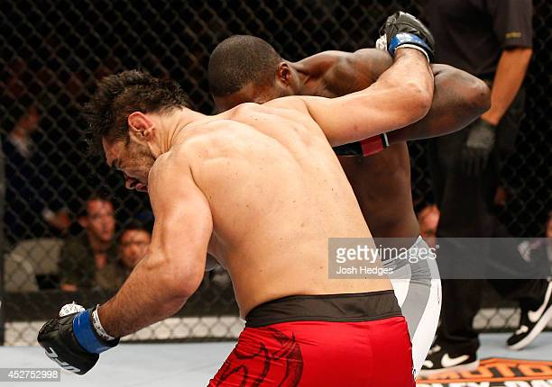 Anthony Johnson lands a straight right to the chin of Antonio Rogerio Nogueira in their light heavyweight bout during the UFC Fight Night event at...