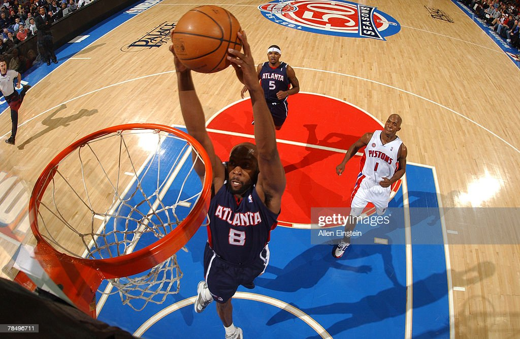 Anthony Johnson #8 of the Atlanta Hawks goes up for a dunk past Chauncey Billups #1 of the Detroit Pistons at the Palace of Auburn Hills December 14, 2007 in Auburn Hills, Michigan.