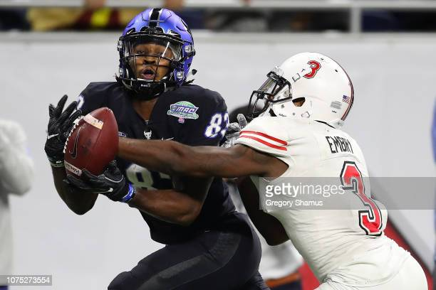 Anthony Johnson of the Buffalo Bulls can't come up with a late fourth quarter catch in front of Jalen Embry of the Northern Illinois Huskies during...