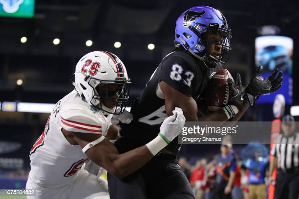 Anthony Johnson of the Buffalo Bulls catches a first half touchdown in front of Adam Buirge of the Northern Illinois Huskies during the MAC...