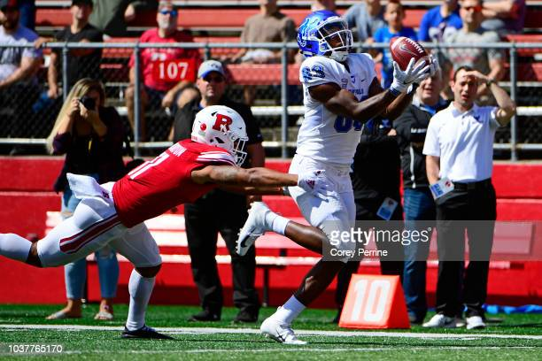 Anthony Johnson of the Buffalo Bulls catches a touchdown pass the first of the game against Isaiah Wharton of the Rutgers Scarlet Knights during the...