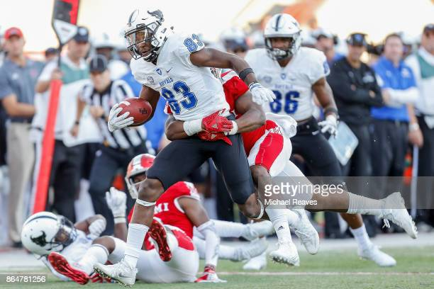 Anthony Johnson of the Buffalo Bulls is tackled by Junior McMullen of the Miami Ohio Redhawks during the second half at Yager Stadium on October 21...