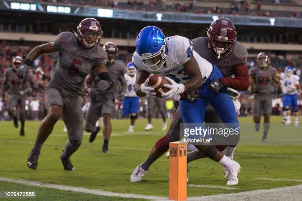 Anthony Johnson of the Buffalo Bulls reaches for the end zone to score a touchdown against Delvon Randall of the Temple Owls in the fourth quarter at...
